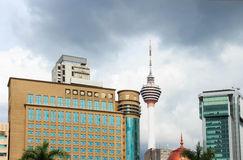 Kuala Lumpur tower with modern buildings. Royalty Free Stock Photos
