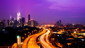 Kuala Lumpur twin towers. With stunning light trail from the busy highway traffic Royalty Free Stock Image