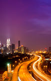 Kuala Lumpur twin towers. With stunning light trail from the busy highway traffic Stock Photo