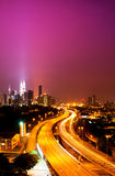 Kuala Lumpur twin towers. With stunning light trail from the busy highway traffic Royalty Free Stock Photos