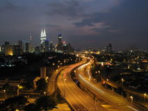 Kuala Lumpur and the twin towers. A great view of Kuala Lumpur with the highway in the middle and the twin towers in the far distance. The shot was taken just Royalty Free Stock Image