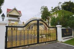Entrance gate to the Sultan`s Palace Istana Maziah in Kuala Terengganu, Malaysia. KUALA TERENGGANU, MALAYSIA - SEPTEMBER 01, 2009: Exterior of the entrance gate Royalty Free Stock Photo