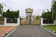 Entrance gate to the Sultan`s Palace Istana Maziah in Kuala Terengganu, Malaysia. KUALA TERENGGANU, MALAYSIA - SEPTEMBER 01, 2009: Exterior of the entrance gate stock images