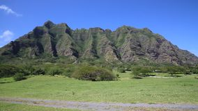 Kualoa Ranch. Landscape with famous Kualoa Ranch Mountains - Oahu, Hawaii stock video