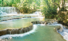 Kuang Si Falls waterfalls near Luang Prabang in Laos PDR. Adventure travel concept with world nature wonders located in south east Asia Royalty Free Stock Photography