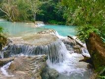Kuang Si Waterfalls, Luang Prabang, Laos. The Kuang Si Falls, sometimes spelled Kuang Xi or known as Tat Kuang Si Waterfalls, is a three levelled waterfall about Stock Image