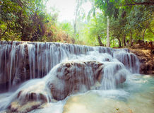 Kuangsi  waterfall in deep forest in Laos Stock Photos