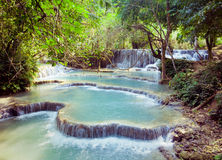 Kuangsi  waterfall in deep forest in Laos Royalty Free Stock Image