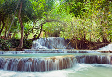 Kuangsi  waterfall in deep forest in Laos Stock Photo
