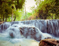 Kuangsi  waterfall in deep forest in Laos Stock Photography