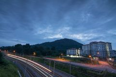 Kuarters KTM Bukit Mertajam, Penang, Malaysia. Kuarters KTM Bukit Mertajam, Penang, Malaysia in morning with vehicle light trail Royalty Free Stock Photo