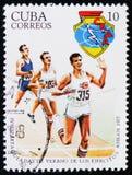 Kubański znaczek pocztowy poświęcać 4 przedstawienie atletyki około 1977 i Spartakiada, Fotografia Royalty Free