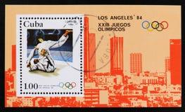 Kuba-Briefmarke zeigt Ringkampf, 23. Sommer-Olympische Spiele, Los Angeles 1984, USA, circa 1983 Lizenzfreie Stockfotografie