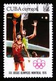 Kuba pokazuje graczów koszykówki, serie poświęcać 21th olimpiady w Montreal, 1976, około 1976 Obrazy Stock