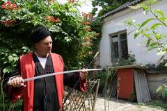 Kuban Cossack checks blade of saber Stock Images