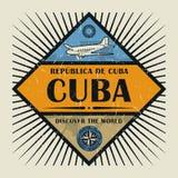 Kuban för stämpel- eller tappningemblemtext, upptäcker världen Arkivbilder
