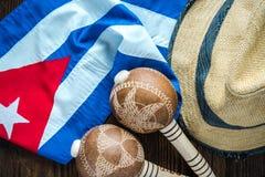 Kubansk flagga, Panama hatt och musikalinstrumet Royaltyfria Foton
