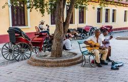Kubanska musiker i fyrkant arkivbild