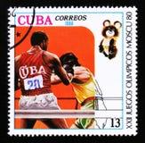Kubaportostämpeln visar boxning, OS i Moskva 1980, circa 1980 Royaltyfri Foto