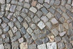 Kubik stena trottoar på gatan royaltyfri foto
