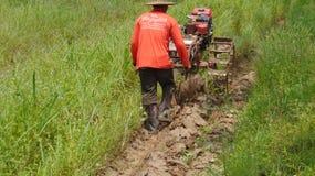 Kubota e fazendeiro Tailândia Imagens de Stock Royalty Free