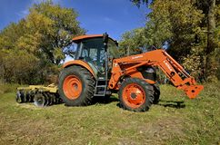Kubota tractor with front end loader Stock Photo