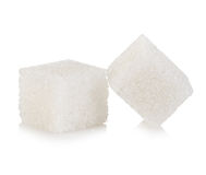 Kubussen van suiker op wit wordt geïsoleerd dat stock foto's