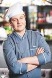 Kucbarski szef kuchni przy restauracją Zdjęcie Royalty Free