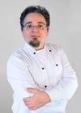 Kucbarski szef kuchni w mundurze na bielu Obraz Royalty Free