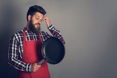 kucharz męską pan fry obraz stock