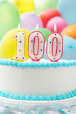 Kuchen, der 100. Geburtstag feiert Stockbild