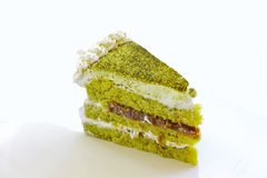 Kuchen des grünen Tees angefüllt mit roter Erbsencreme Lizenzfreie Stockfotografie