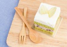 Kuchen des grünen Tees auf hölzernem Hintergrund, geschmackvoller Kuchen Stockfotografie