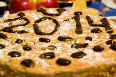 Kuchen 2014 des neuen Jahres Stockbild