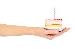 Kuchen mit einer Kerze stockfoto