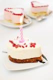 Kuchen mit einer Kerze Stockbild