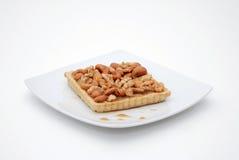 Kuchen mit Nüssen und Kaffee Lizenzfreies Stockfoto