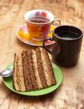 Kuchen mit Tee oder Kaffee Stockfotografie