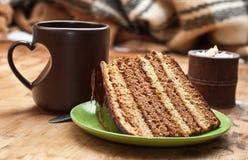 Kuchen mit Tee oder Kaffee Stockbilder