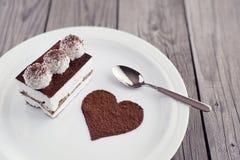 Kuchen und abstraktes Herz Stockfoto