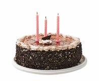 Kuchen und drei Kerzen Stockfotos
