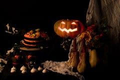 Kuchen und Kürbis Helloweens Stockfoto