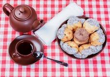 Kuchen und Tee Lizenzfreie Stockbilder