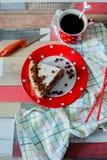 Kuchen und Tee in einem Topftupfen Stockbild
