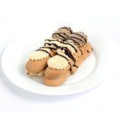 Kuchenstücke Schokoladen- und Vanillefüllung Lizenzfreies Stockfoto