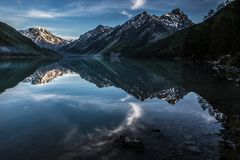 Kucherlinsky lake in Altai mountains in the evening in summer. Kucherlinsky lake with beautiful reflection in Altai mountains in the evening in summer Royalty Free Stock Photos