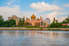 Kuching City Mosqueat day time, Sarawak, Malaysia. Masjid Bahagian. Pink mosque against cloudy sky Royalty Free Stock Images