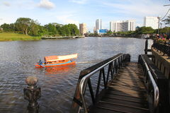 Kuching city riverside with traditional boat Royalty Free Stock Photography