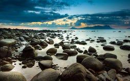 wonderful sunrise colour with many stone beach stock photography