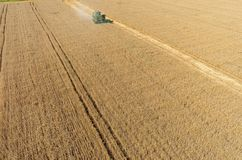 Agriculture machine harvesting crop in field Stock Photo